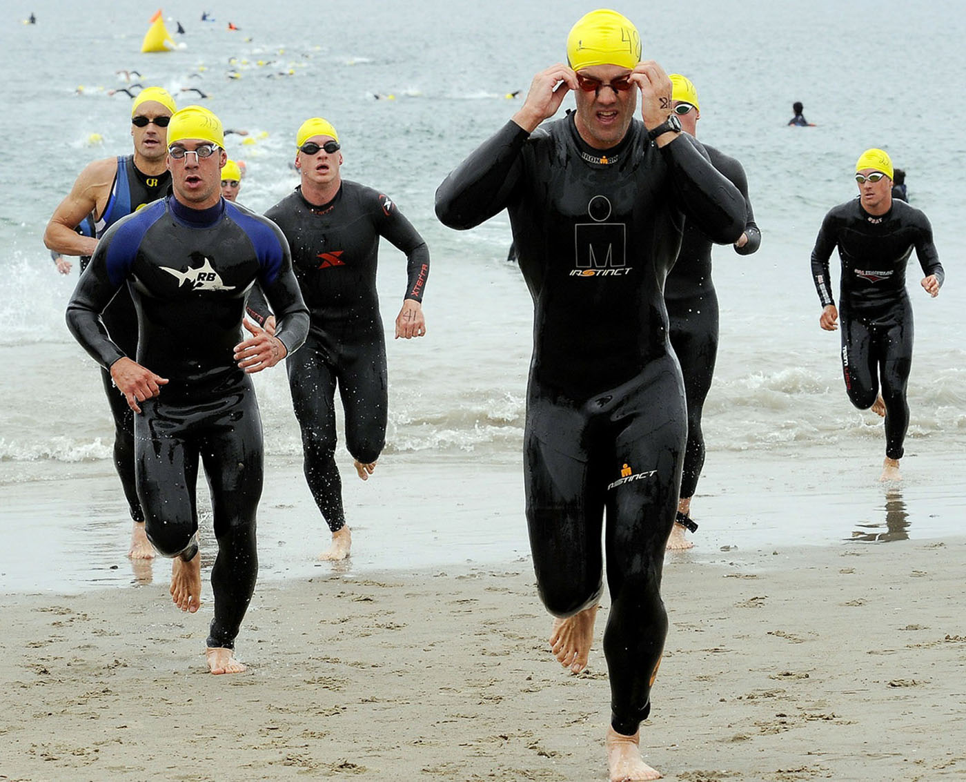 Triathlon runners on the beach